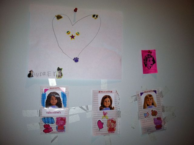 Dolls on daddy's office wall